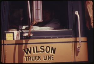 DRIVER_IN_THE_CAB_OF_A_LARGE_CATTLE_TRUCK_IN_COTTONWOOD_FALLS,_KANSAS,_NEAR_EMPORIA._SUCH_VEHICLES_AND_HORSES_ARE_THE..._-_NARA_-_557044.tif